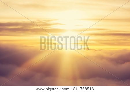 Beautiful blazing sunrise landscape above clouds. View from aircraft. Sunset and sunrise concept background.