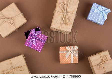 Handmade Gift Boxes On Brown Paper Background. Top View