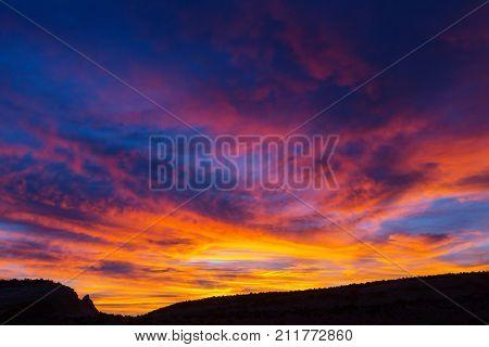 Beautiful blazing sunrise landscape.  Sunset and sunrise concept background.