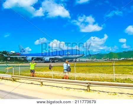 Philipsburg, Sint Maarten, Kingdom of the Netherlands - February 10, 2013: The people making photo at beach Maho Bay is one of the world's premier planespotting destinations.