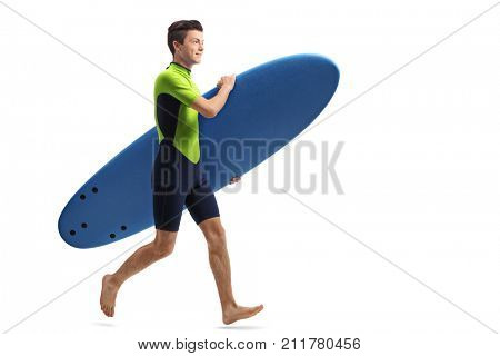 Full length profile shot of a teenage surfer with a surfboard running isolated on white background