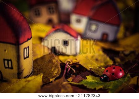 Fairytale Dwarf Houses And A Ladybug In Autumn Forest. Handmade Wooden Toys