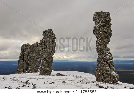 Manpupuner rock formations. Giant rocks at the Manpupuner Plateau, Northern Ural. One of the seven wonders of Russia