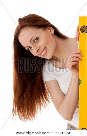 Female Construction Worker With  Level.