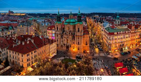 PRAGUE, CZECH REPUBLIC - DECEMBER 10, 2015: Panoramic city skyline view, illuminated buildings and Christmas market on Old Town Square in Prague - popular destination with tourists on winter holidays.