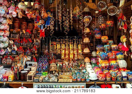 PRAGUE, CZECH REPUBLIC - DECEMBER 10, 2015: Decorations and souvenirs in kiosk on traditional Christmas market at Old Town Square - popular tourist destination, fifth most visited European city.