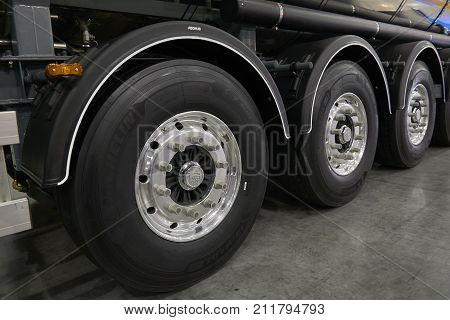 MOSCOW, SEP, 5, 2017: View on new heavy fuel tank trailer wheels with Michelin tires. Fuel tanker truck chassis exhibit on Commercial Transport Exhibition ComTrans-2017 Fuel truck trailer transmission