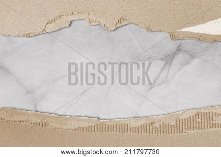 old paper of Packaging box isolated on marble background. brown paper rip