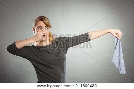 Disgusted Woman Holds Dirty Rag.