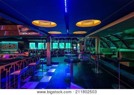 Decorative lightening ceiling in modern discotheque interior