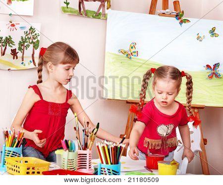 Children painting colour pencil in preschool.