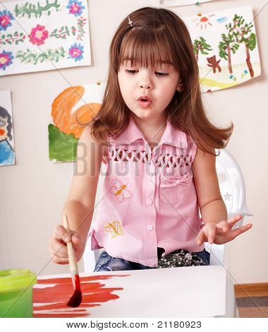 Child paint picture in preschool. Child care. poster