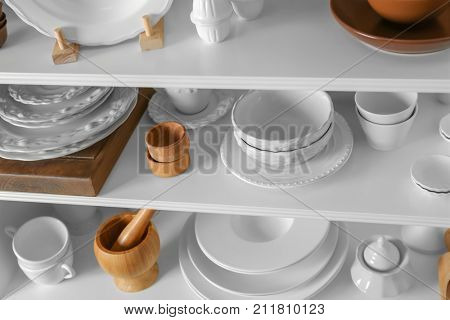 Storage stand with tableware indoors