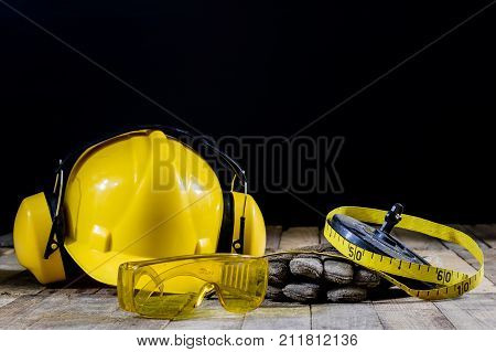 Helmet, Hearing Protection, Tools, Workshop Table. Safety Equipment And Tools.