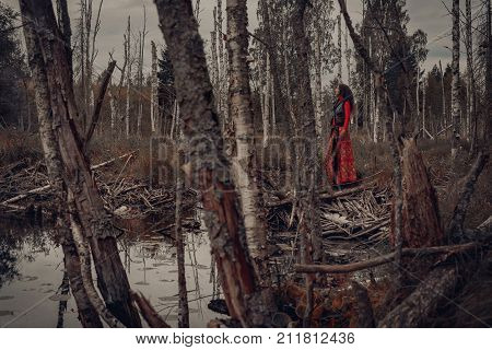attractive young woman in forest. mystery witch craft concept