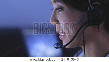Woman customer services working at night, 24 hour working concept