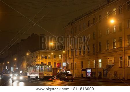 SAINT PETERSBURG, RUSSIA - NOVEMBER 03, 2014: Night traffic in the center of Saint Petersburg (between 1924 and 1991 named Leningrad). St. Petersburg was founded by Tsar Peter the Great on 1703.