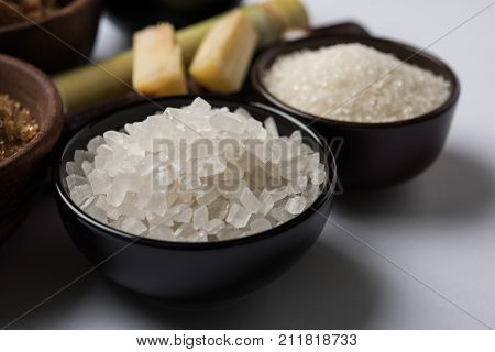 Jaggery, Sugar and cane - by-products of sugar cane or ganna like gur or jaggery, raw brown and refined white sugar, rock sugar crystals or mishri in Hindi. Selective focus