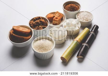 Jaggery, Sugar and cane - by-products of sugar cane or ganna like gur or jaggery, raw brown and refined white sugar, rock sugar crystals or mishri in Hindi. Selective focus poster