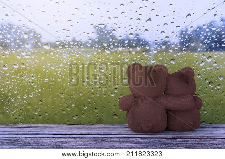 A photo of Two teddy bear hugging with water drop on glass background 3D rendering with blender freeware