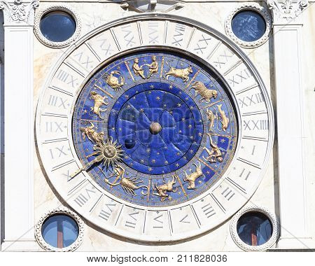 St Mark's Clock tower on Piazza San Marco clock face Venice Italy.The clock shows the hours the moon phase and the zodiac signs
