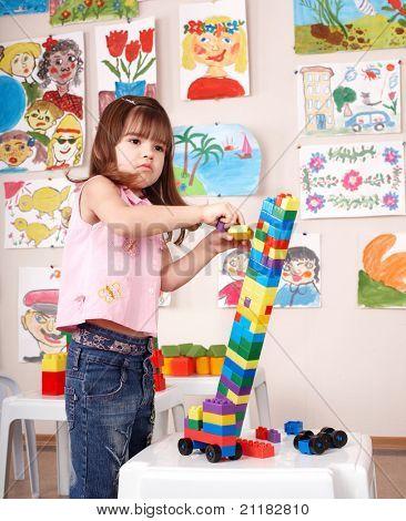 Child playing construction set.