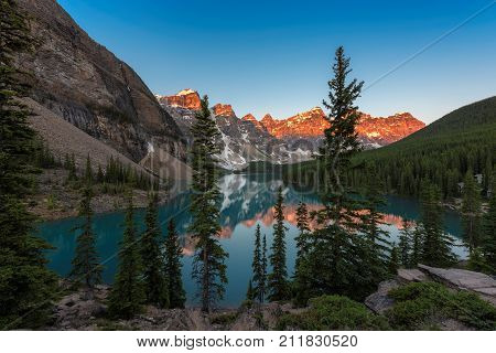 Sunrise at Rocky Mountains - Moraine lake in Banff National Park of Canada