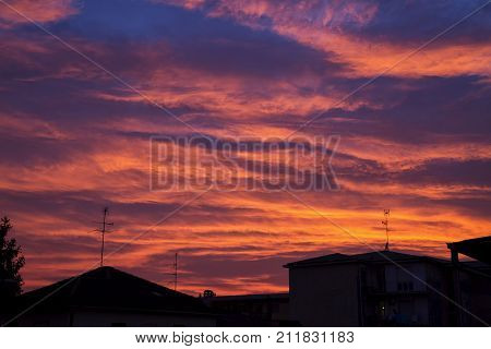 Wonderful sunset sky over town horizontal image
