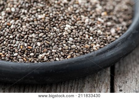Healthy Chia Seeds In A Spoon On The Table Close-up. Nutritious Chia Seeds