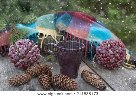 Cup Of Hot Tea On A Rustic Wooden Table. Still Life Of Cones, Patskthread, Fir Branches.