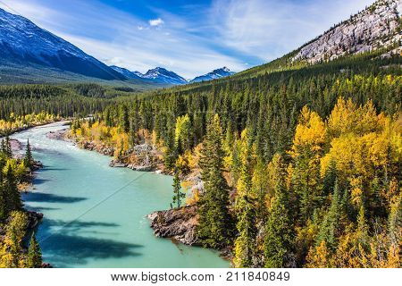 Abraham Lake is the beautiful lake in the Rockies. Dense forests cover the lake shores. Warm sunny day in autumn. The concept of ecological and active tourism