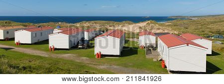 Static caravans with panoramic view to beautiful Cornish coast in summer with beautiful blue sky