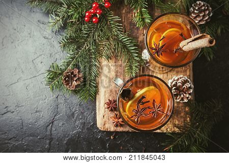 Christmas or Thanksgiving drink. Autumn and winter cocktail - grog, hot sangria, mulled wine with tea, lemon, rome, cinnamon, anise and other spices. top view
