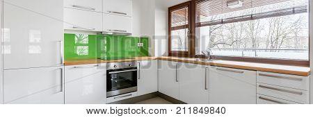 Modern, White Kitchen With Window