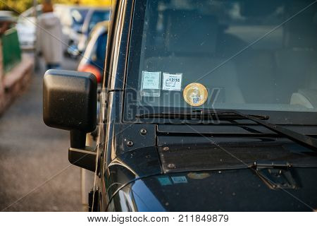 STRASBOURG FRANCE - NOV 1 2017: Mandatory Air Quality Certificate Crit'Air certifying the vehicle's environmental class based on pollutant emissions - sticker on windshield