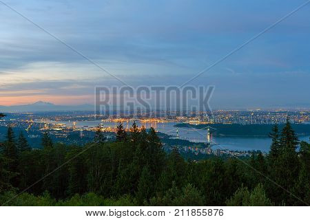 Vancouver British Columbia Canada cityscape mountain Stanley Park aerial view during early morning dawn