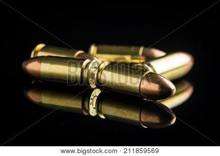 9mm pistol bullets on black table.
