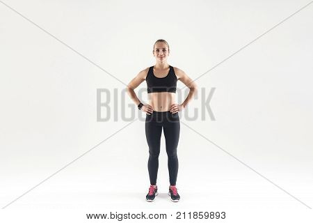 Beautiful Woman In Sports Wear, Looking At Camera And Smiling
