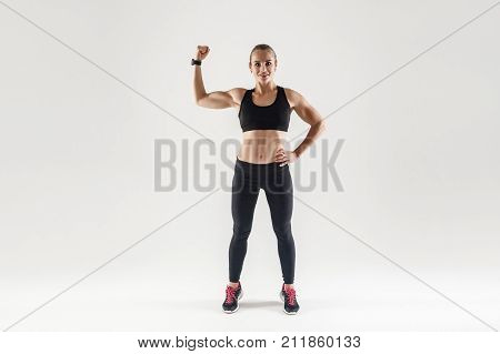 Bodybuilder, Muscular Girl Engaged Fitness. Woman Showing Her Biceps