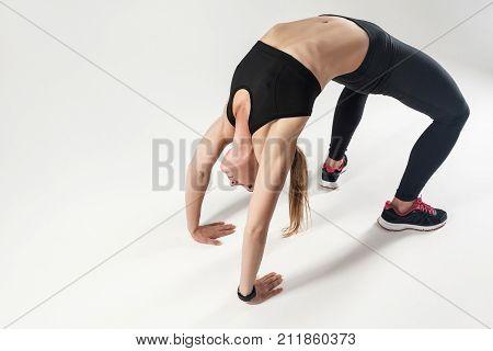 Pilates Pose. Athletic Woman Doing Hard Exercising.