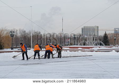 Moscow Russia - January 15 2016: Workers clean snow from sidewalks on Poklonnaya Hill in Moscow