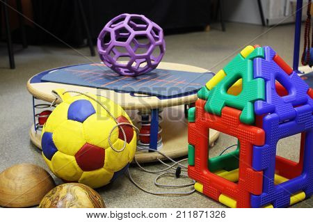 Outdoor games for kids. A children's playroom. Toys for kids. Football for children. Abstract objects, Soccer balls, mosaic, puzzle, balls for the development of mental abilities, logical thinking. Games for children in playroom