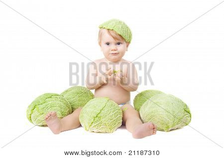 Small Baby And A Savoy Cabbage Isolated On White
