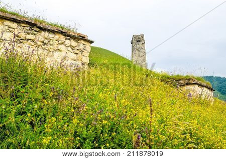 Picturesque view of ancient watchtower of City of the Dead in republic of North Ossetia, Russia