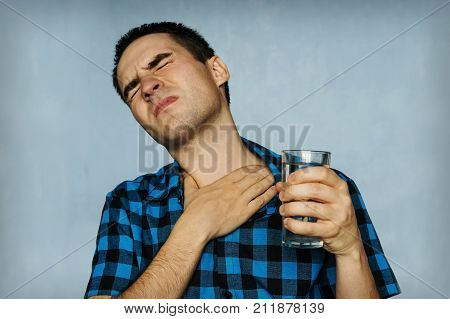 Portrait Man Coughing, Pressing On Chest With Painful Expression.