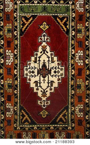 background Turkish silk carpet with floral ornament