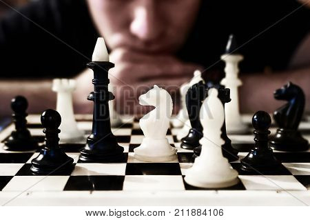 man thinking how to play chess. concept strategy for win. Want to see the chess pieces on the Board.