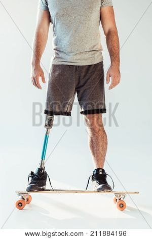 Man With Leg Prosthesis Standing On Skateboard
