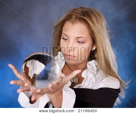 Young beautiful woman with crystal ball. poster