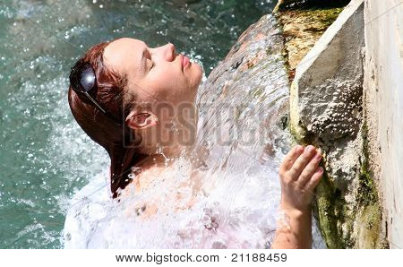 Attractive Woman At The Source Of The Mineral Waters Of Pamukkale
